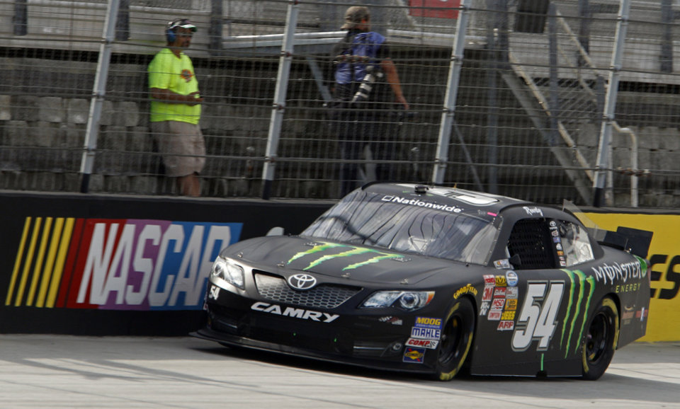 Photo - Kyle Busch (54) makes his way around the track during qualifying for the Food City 300 NASCAR Nationwide Series auto race at Bristol Motor Speedway on Friday, Aug. 22, 2014, in Bristol, Tenn. Busch will start on the pole. (AP Photo/Wade Payne)