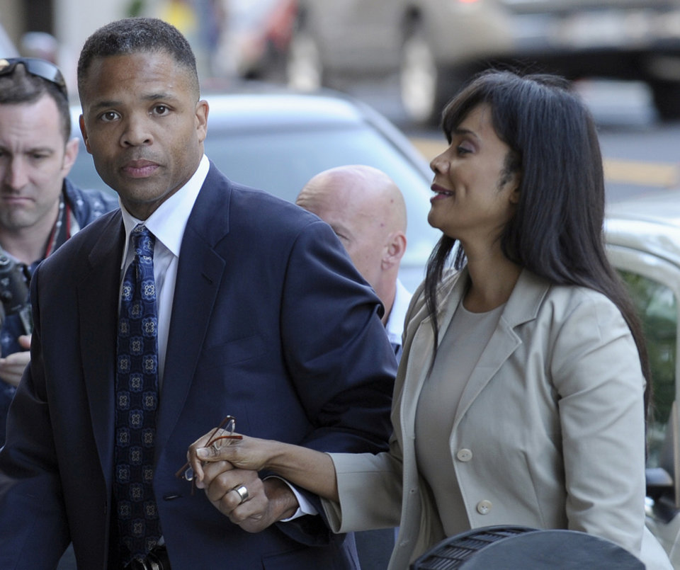 Photo - Former Illinois Rep. Jesse Jackson Jr. and his wife, Sandra, arrive at federal court in Washington, Wednesday, Aug. 14, 2013, to learn their fates when a federal judge sentences the one-time power couple for misusing $750,000 in campaign money on everything from a gold-plated Rolex watch and mink capes to vacations and mounted elk heads. (AP Photo/Susan Walsh)