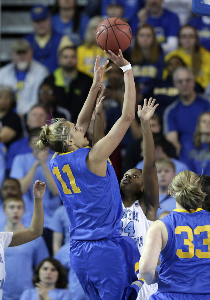 Delaware guard/forward Elena Delle Donne (11) shoots over North Carolina forward Xylina McDaniel during the first half of a second-round game in the women's NCAA college basketball tournament in Newark, Del., Tuesday, March 26, 2013. (AP Photo/Patrick Semansky)