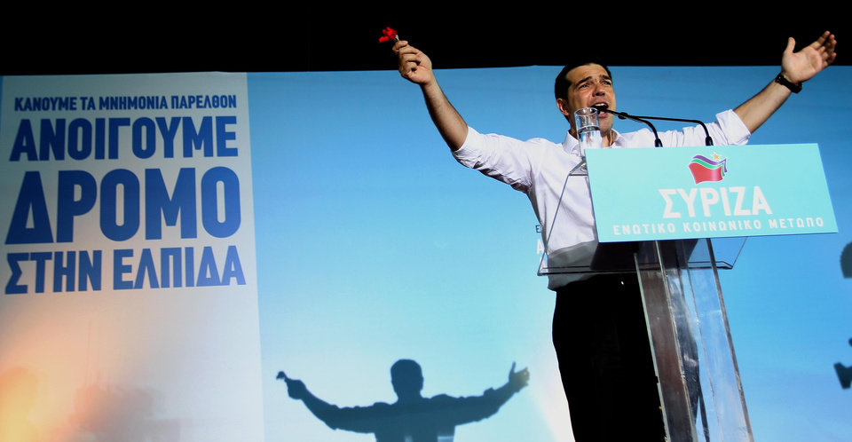 Photo -   Head of Greece's radical left-wing Syriza party Alexis Tsipras waves to his supporters during a rally at Omonia square in Athens, Thursday, June 14, 2012. Greece faces crucial national elections on Sunday, that could ultimately determine whether the debt-saddled, recession bound country remains in the eurozone. (AP Photo/Petros Karadjias)