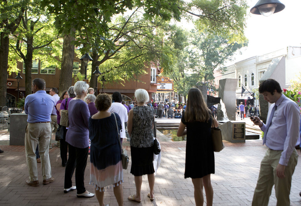 Photo - A crowd lines up outside the Paramount Theater for a memorial service for Heather Heyer Wednesday, Aug. 16, 2017 in Charlottesville, Va. Heyer was killed Saturday, when a car rammed into a crowd of people protesting a white nationalist rally.   (AP Photo/Julia Rendleman)