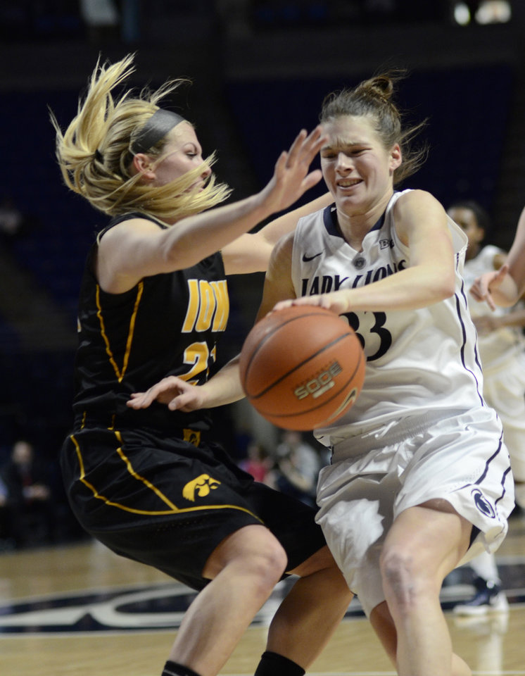 Photo - Penn State's Maggie Lucas (33) is fouled by Iowa's Kali Peschel (25) during first half  of an NCAA college basketball game on Thursday, Feb. 6, 2014 in State College, Pa. (AP Photo/Ralph Wilson)