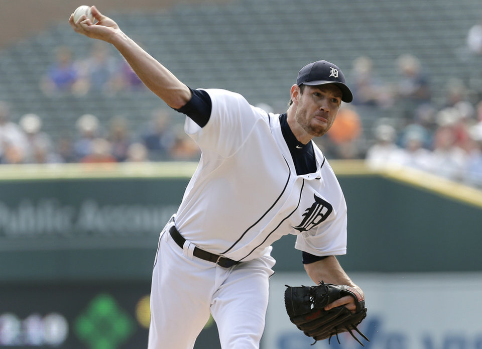 FILE - In this Sept. 19, 2013, file photo, Detroit Tigers starting pitcher Doug Fister throws against the Seattle Mariners during a baseball game in Detroit. The Tigers have traded Fister to the Washington Nationals for three players announced Monday, Dec. 2. (AP Photo/Paul Sancya, File)