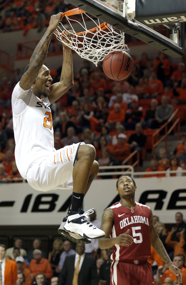 Photo - Oklahoma State's Kamari Murphy (21) dunks in front of Oklahoma's Je'lon Hornbeak (5) during the men's Bedlam college game between Oklahoma and Oklahoma State at Gallagher-Iba Arena in Stillwater, Okla., Saturday, Feb. 15, 2014. Photo by Sarah Phipps, The Oklahoman