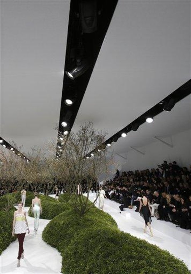 Photo - Models present creations by Raf Simons for Christian Dior's Spring Summer 2013 Haute Couture fashion collection, presented in Paris, Monday, Jan.21, 2013. (AP Photo/Christophe Ena)