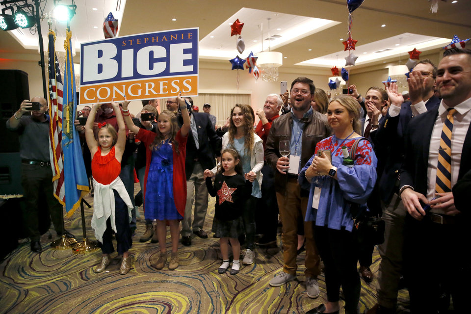 Photo - Stephanie Bice  supporters cheer during a Republican Party election night watch party in Edmond, Okla., after winning the 5th District Congressional seat, Tuesday, Nov. 3, 2020. [Bryan Terry/The Oklahoman]