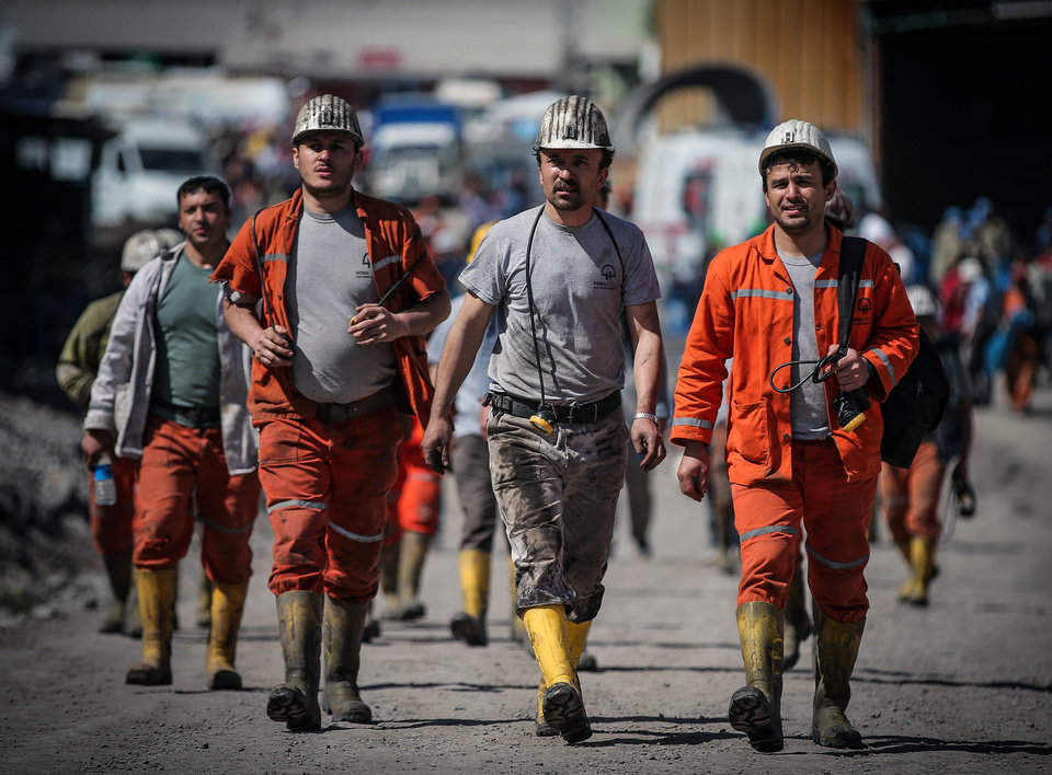 Photo - Rescue workers walk toward the mine in Soma, Turkey, Friday, May 16, 2014. A Turkish mining company defended its safety record Friday, four days after over 250 people died in an underground blaze at its coal mine in western Turkey. (AP Photo/Emrah Gurel)