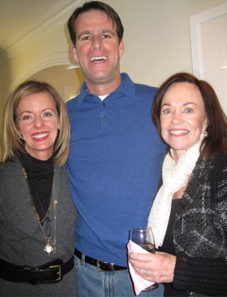 Photo -  Penny McCaleb, Brian Henderson and Connie Givens enjoy the party.