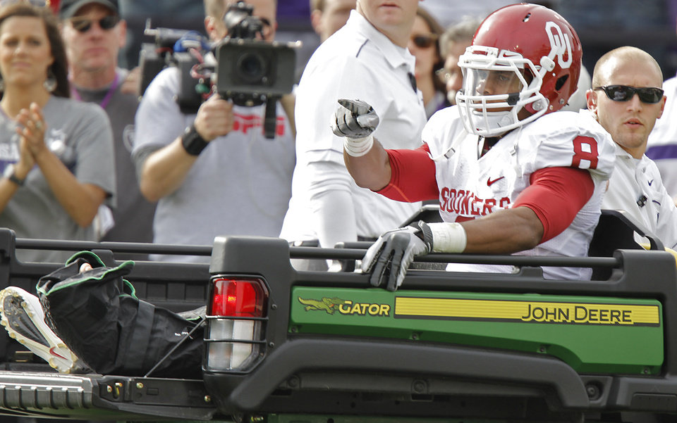Oklahoma Sooners\' Dominique Whaley (8) points to the offense as he is carted off the field with an injury during the college football game between the University of Oklahoma Sooners (OU) and the Kansas State University Wildcats (KSU) at Bill Snyder Family Stadium on Saturday, Oct. 29, 2011. in Manhattan, Kan. Photo by Chris Landsberger, The Oklahoman ORG XMIT: KOD
