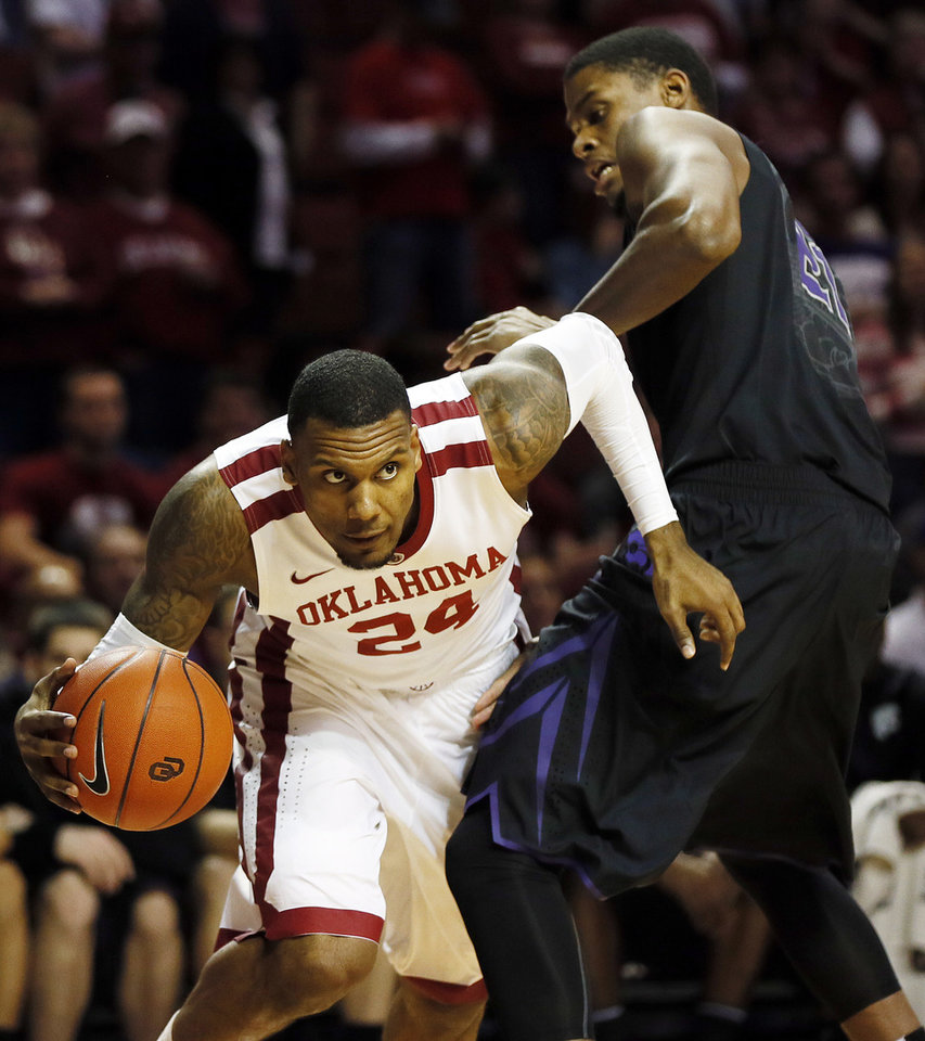 Oklahoma's Romero Osby (24) drives against Kansas State's Jordan Henriquez (21) during an NCAA men's basketball game between the University of Oklahoma (OU) and Kansas State at the Lloyd Noble Center in Norman, Okla., Saturday, Feb. 2, 2013. Photo by Nate Billings, The Oklahoman