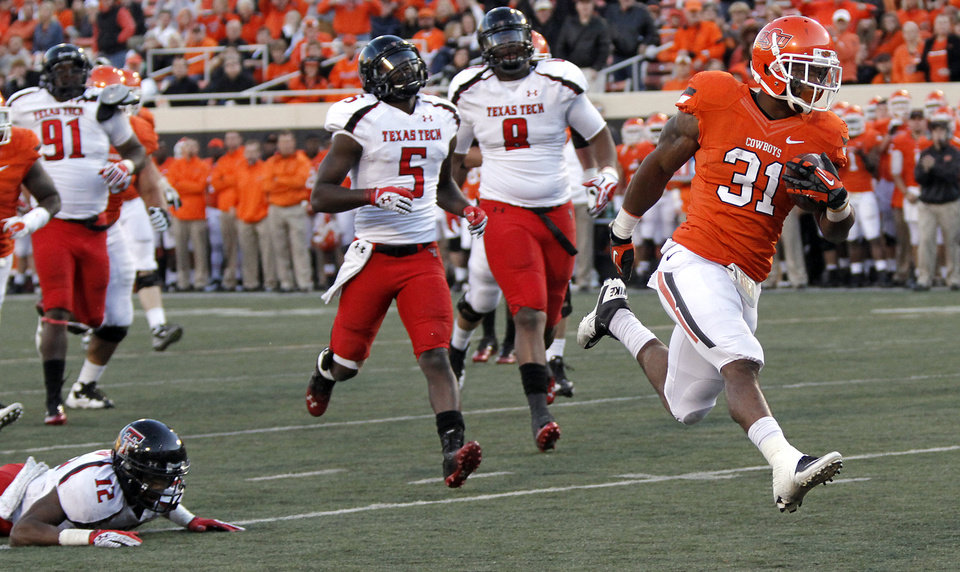 Photo - Oklahoma State's Jeremy Smith (31) runs past the Texas Tech defense for a touchdown during the college football game between the Oklahoma State University Cowboys (OSU) and Texas Tech University Red Raiders (TTU) at Boone Pickens Stadium on Saturday, Nov. 17, 2012, in Stillwater, Okla.   Photo by Chris Landsberger, The Oklahoman