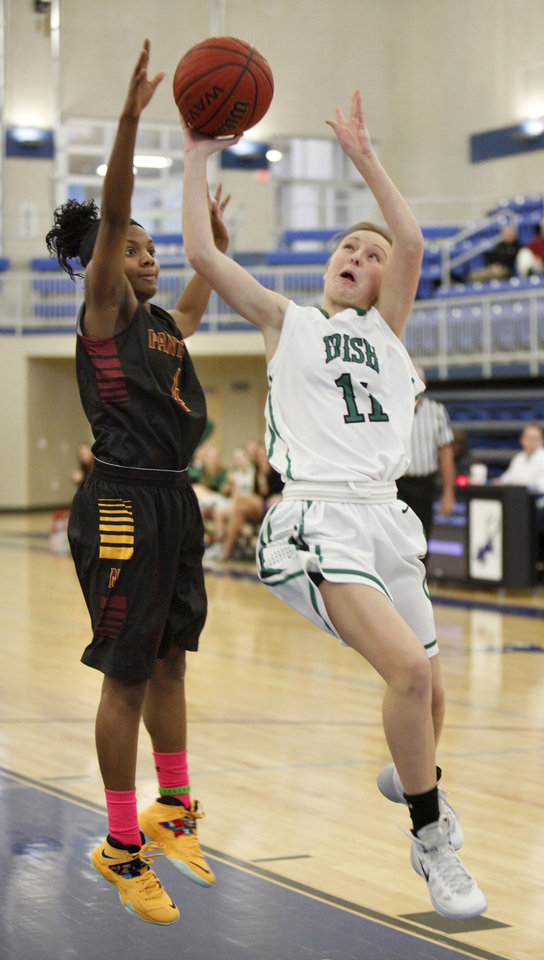 Photo - Bishop McGuinness' Elizabeth Jantz goes up for a shot past PC North's Sidney Carolina during the Bishop McGuinness vs. PC North girls game of the Deer Creek, Bruce Gray Invitational basketball game at Deer Creek High School in Oklahoma City, OK, Thursday, January 23, 2014,  Photo by Paul Hellstern, The Oklahoman