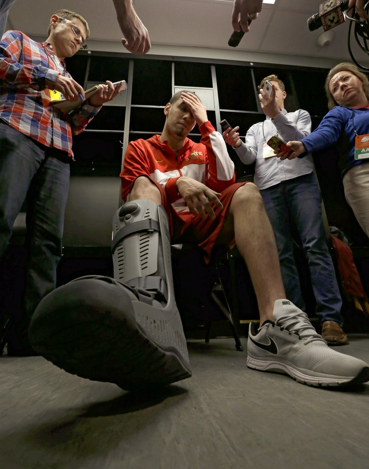 Photo - Iowa State's Georges Niang wipes his head as he talks with reporters before an NCAA college basketball tournament practice Saturday, March 22, 2014, in San Antonio. Niang, who broke his foot during Friday's game against North Carolina Central, with not play when Iowa State plays North Carolina Sunday. (AP Photo/David J. Phillip)