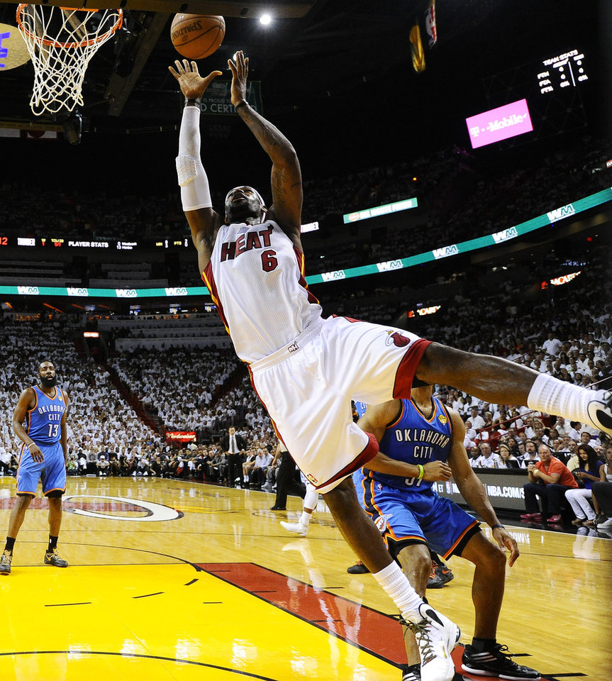 Photo - Miami Heat small forward LeBron James (6) shoots against the Oklahoma City Thunder during the first half at Game 3 of the NBA Finals basketball series, Sunday, June 17, 2012, in Miami. (AP Photo/Larry W. Smith, Pool) ORG XMIT: NBA132