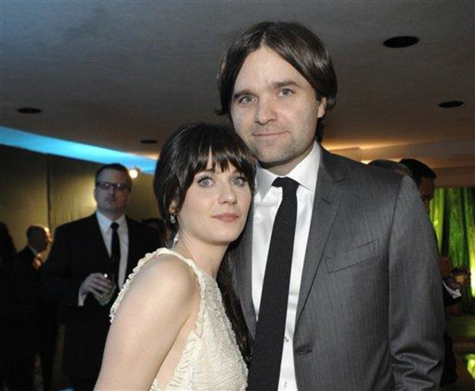 FILE - In this Jan. 16, 2011 file photo, actress Zooey Deschanel, left, and her husband, singer Ben Gibbard attend the 2011 HBO Golden Globe Party in Beverly Hills, Calif. Court records show a Los Angeles judge finalized the former couple\'s divorce on Wednesday Dec. 12, 2012. The pair were married in 2009 and separated in October 2011. (AP Photo/Dan Steinberg, file)