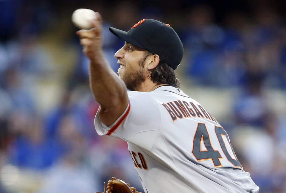 Photo - San Francisco Giants starting pitcher Madison Bumgarner delivers against the Los Angeles Dodgers during the first inning of a baseball game, Friday, May 9, 2014, in Los Angeles. (AP Photo/Danny Moloshok)