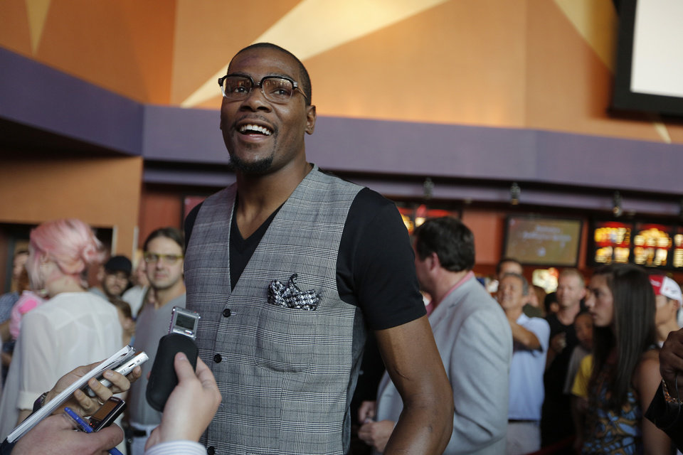 "Photo -  Oklahoma City Thunder NBA basketball player Kevin Durant answers questions during the red carpet movie premiere of ""Thunderstruck"" at Harkins Bricktown Theatre in Oklahoma City, Sunday, Aug. 19, 2012. (AP Photo/The Oklahoman, Garett Fisbeck) ORG XMIT: OKOKL204"