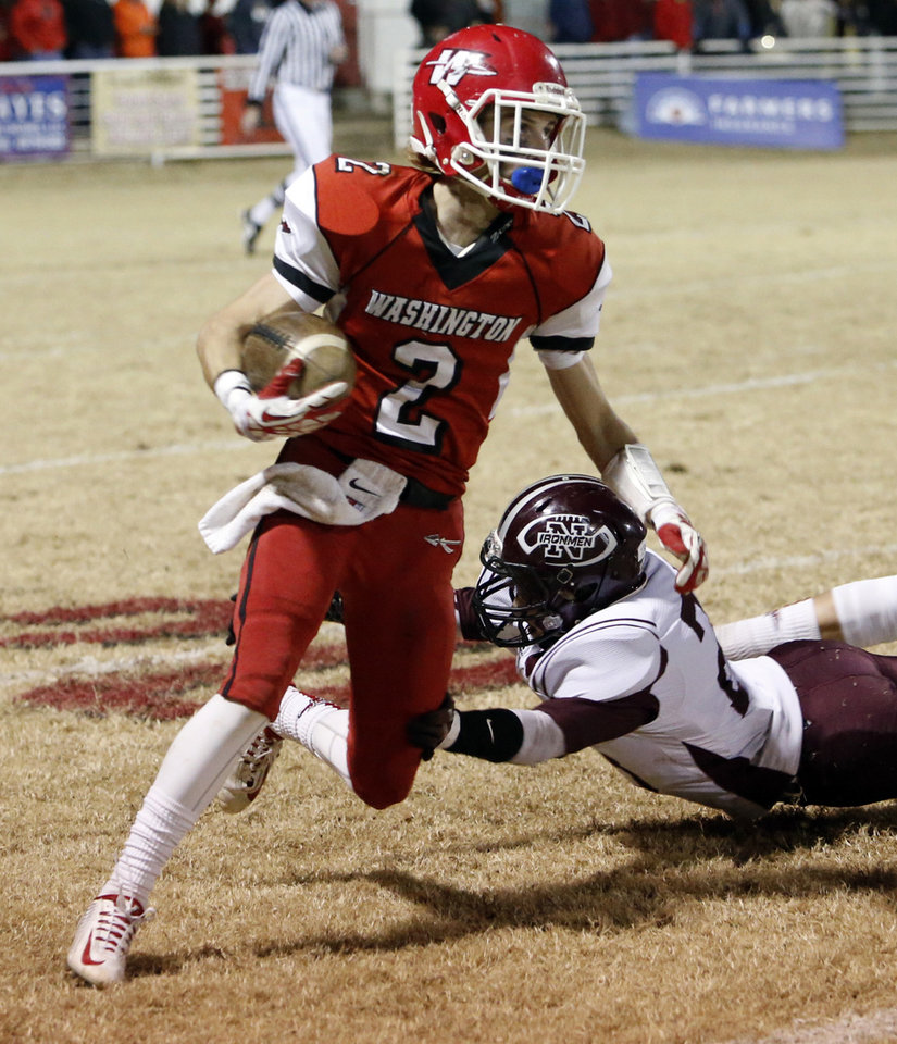 Photo - Brady Kulbeth returns a kickoff as the Nowata Ironmen play the Washington Warriors in high school football on Friday, Nov. 28, 2014 in Washington, Okla. Photo by Steve Sisney, The Oklahoman