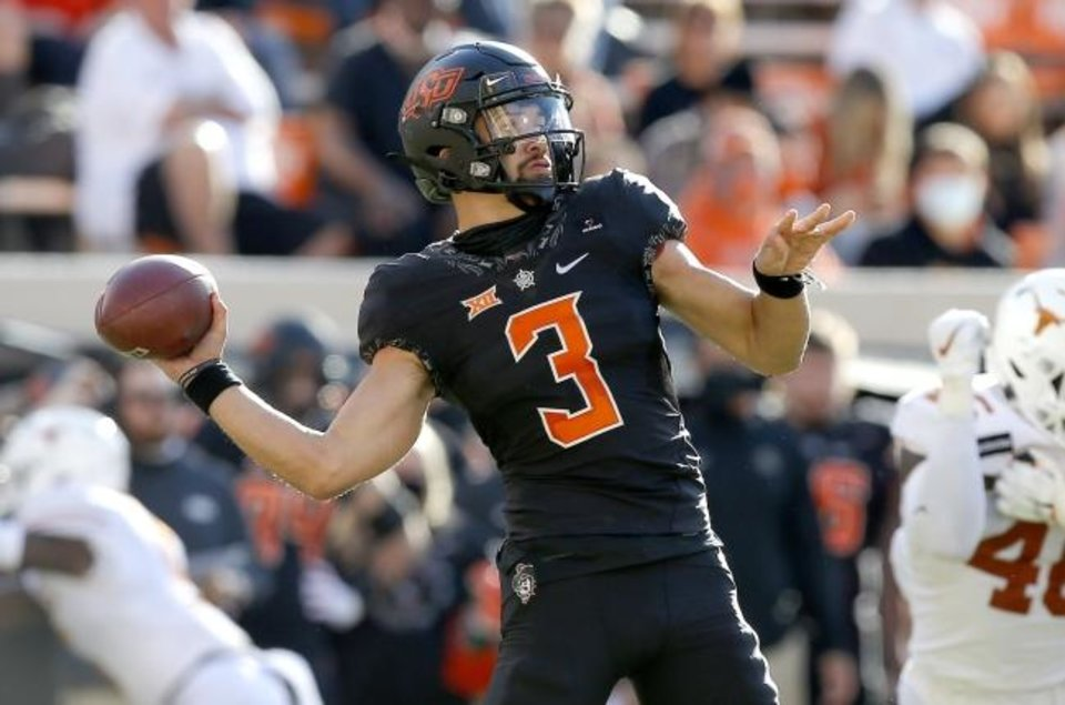 Photo -  Saturday's Bedlam contest will mark redshirt sophomore quarterback Spencer Sanders' 15th career start at Oklahoma State. [Sarah Phipps/The Oklahoman]
