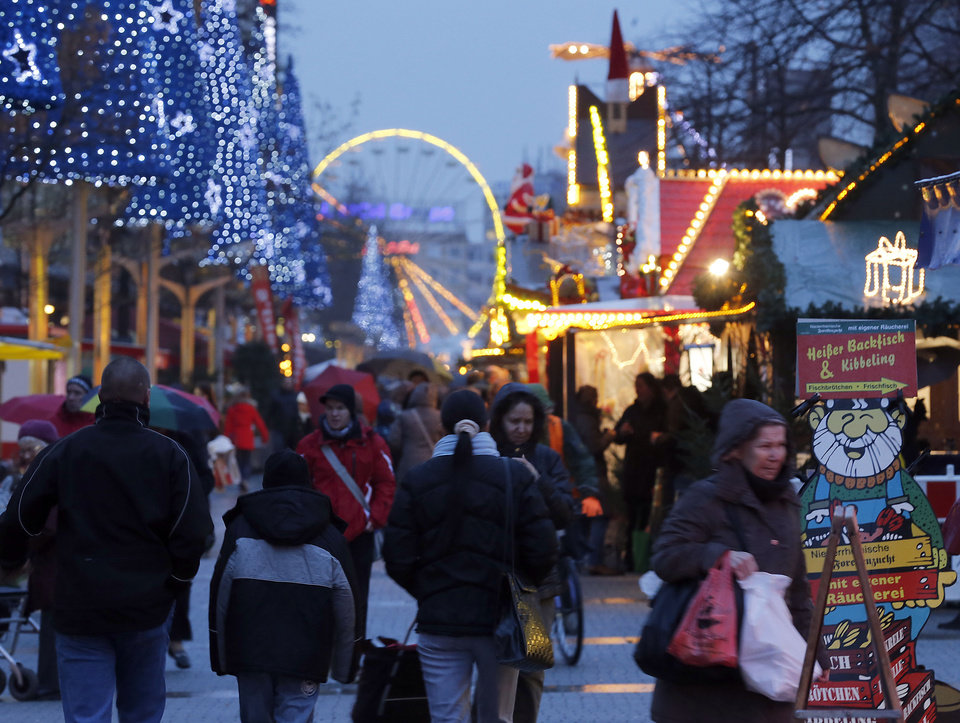 "Shoppers stroll through downtown Duisburg, Germany, Thursday, Dec. 20, 2012. Analysts and shopkeepers say sales have been slow so far this season. But many are hoping for a late push the final weekend before Christmas. ""Every year it comes later,� said Joachim Stoll, who co-owns Leder-Stoll OHG, a leather and luggage retailer just off the glittering Zeil pedestrian shopping quarter in Frankfurt, Germany.  �People wait longer and longer, even after Christmas.� As in the U.S., Christmas sales are vital to shopkeepers: British non-food retailers can make up to 50 percent of their profits in the end-of-year push. In Germany, Christmas business can mean 30 percent of annual sales for holiday-heavy sectors like toys. (AP Photo/Frank Augstein)"