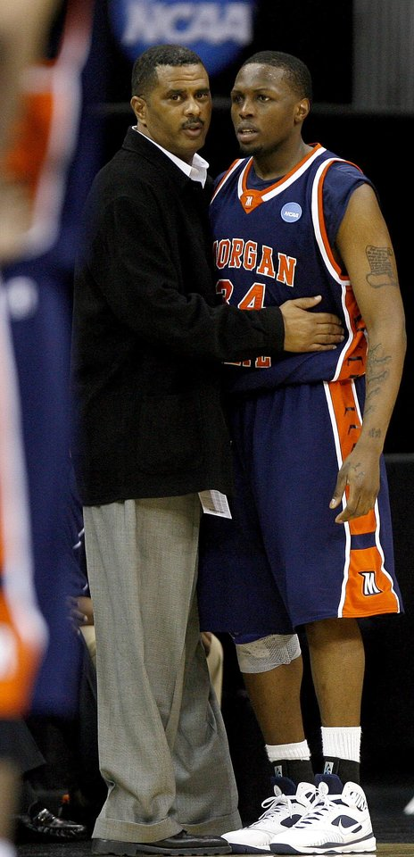 Photo - Morgan State coach Todd Bozeman talks with Ameer Ali after he was ejected from the game during a first round game of the men's NCAA tournament between Oklahoma and Morgan State in Kansas City, Mo., Thursday, March 19, 2009.  PHOTO BY BRYAN TERRY, THE OKLAHOMAN