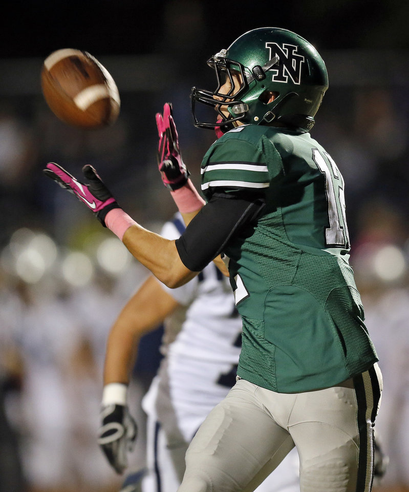 Photo - Norman North's Jake Higginbotham (12) makes a touchdown catch during a high school football game between Edmond North and Norman North in Norman, Okla., Thursday, Oct. 11, 2012. Photo by Nate Billings, The Oklahoman