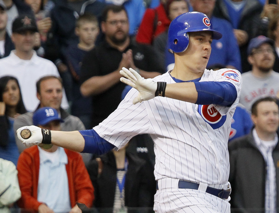 Chicago Cubs' Bryan LaHair hits the game-winning RBI single off Houston Astros relief pitcher Hector Ambriz during the ninth inning of a baseball game, Wednesday, Oct. 3, 2012, in Chicago. The Cubs won 5-4. (AP Photo/Charles Rex Arbogast)