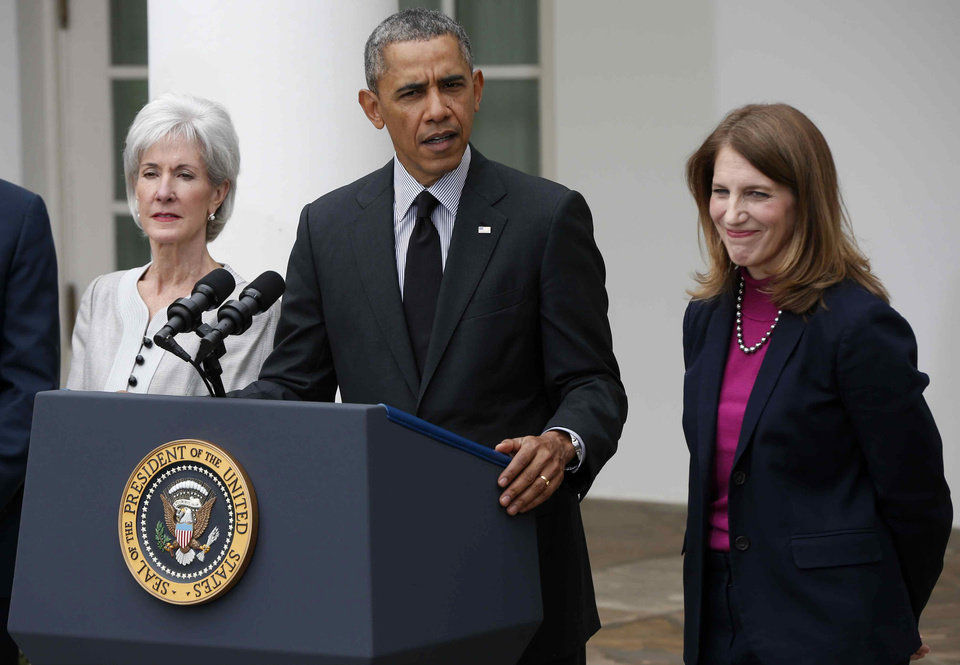 Photo - President Barack Obama, flanked by outgoing Health and Human Services Secretary Kathleen Sebelius, left, and his nominee to be her replacement, Budget Director Sylvia Mathews Burwell, speaks in the Rose Garden of the White House in Washington, Friday, April 11, 2014. The moves come just over a week after sign-ups closed for the first year of insurance coverage under the so-called Obamacare law. (AP Photo/Charles Dharapak)
