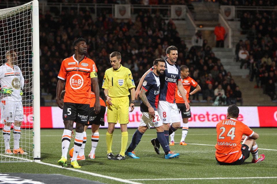 Photo - Paris Saint Germain's forward Ezequiel Lavezzi (22) and Thiago Motta (8) jubilate after Motta scored the first goal during their French League one soccer match against Lorient, in Lorient, western France, Friday, March 21, 2014. (AP Photo/David Vincent)