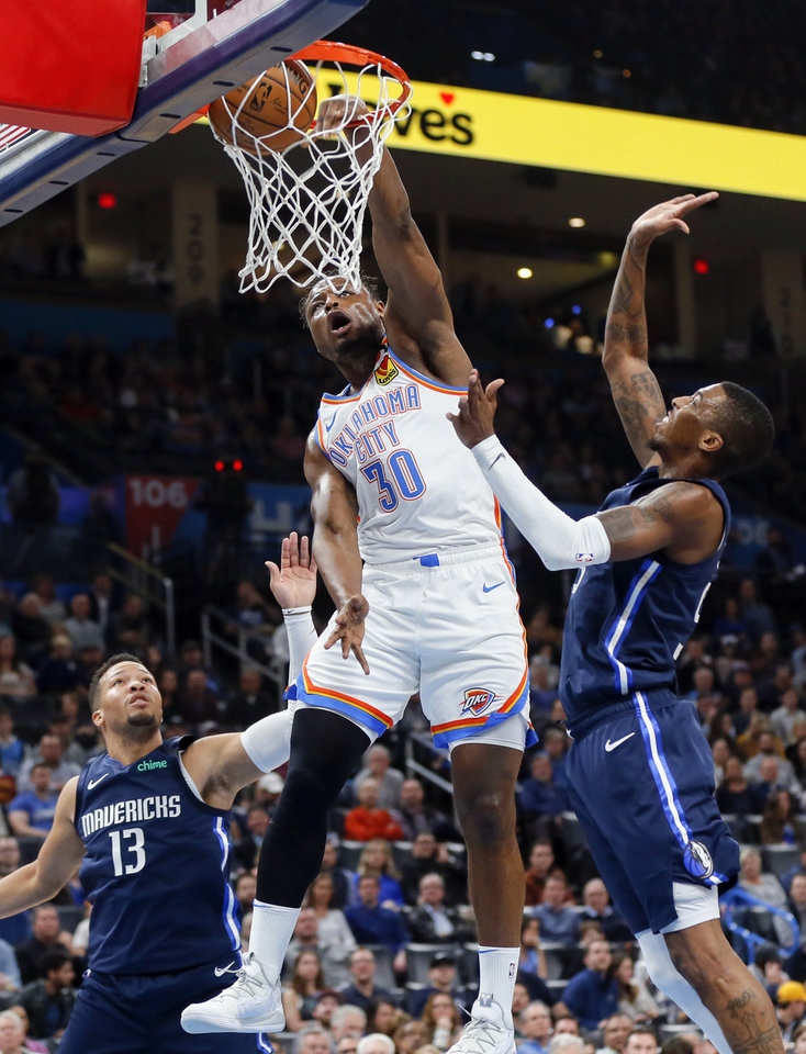 Photo - Oklahoma City's Deonte Burton (30) dunks the ball in the second quarter between Dallas' Jalen Brunson (13), left, and Delon Wright (55) during an NBA basketball game between the Oklahoma City Thunder and Dallas Mavericks at Chesapeake Energy Arena in Oklahoma City, Monday, Jan. 27, 2020. [Nate Billings/The Oklahoman]