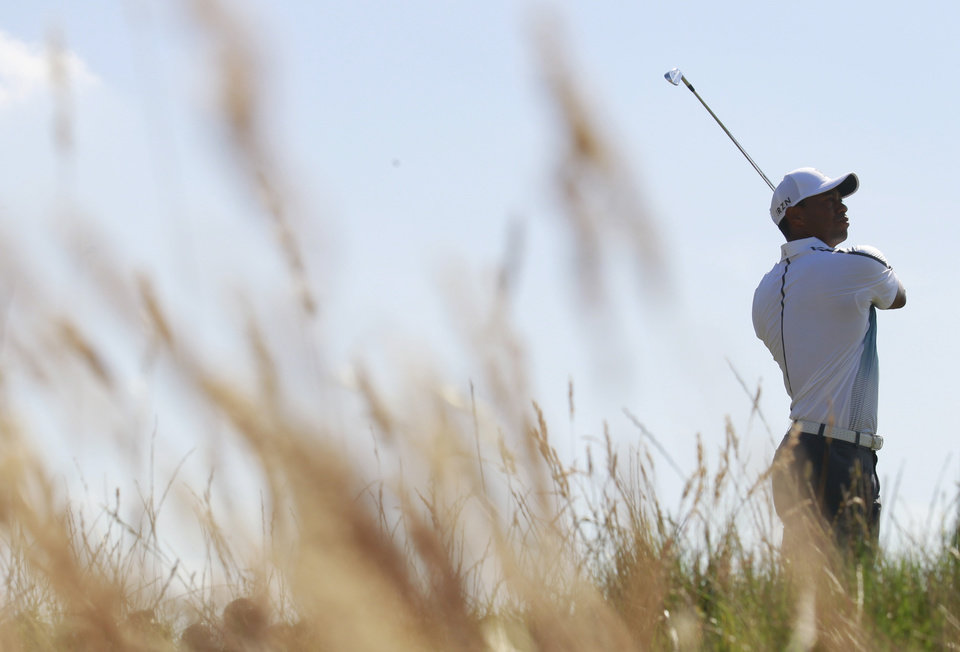 Photo - Tiger Woods of the US plays a shot off the 6th tee during the first day of the British Open Golf championship at the Royal Liverpool golf club, Hoylake, England, Thursday July 17, 2014. (AP Photo/Peter Morrison)
