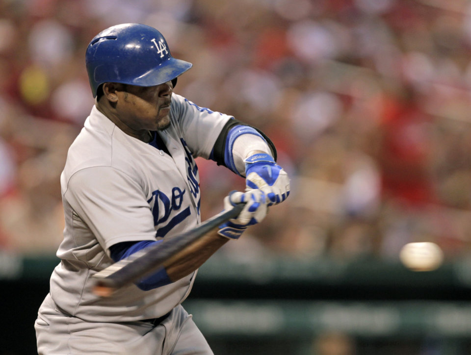 Photo - Los Angeles Dodgers' Juan Uribe connects for a single in the fourth inning of a baseball game against the St. Louis Cardinals, Sunday, July 20, 2014 in St. Louis.  (AP Photo/Tom Gannam)