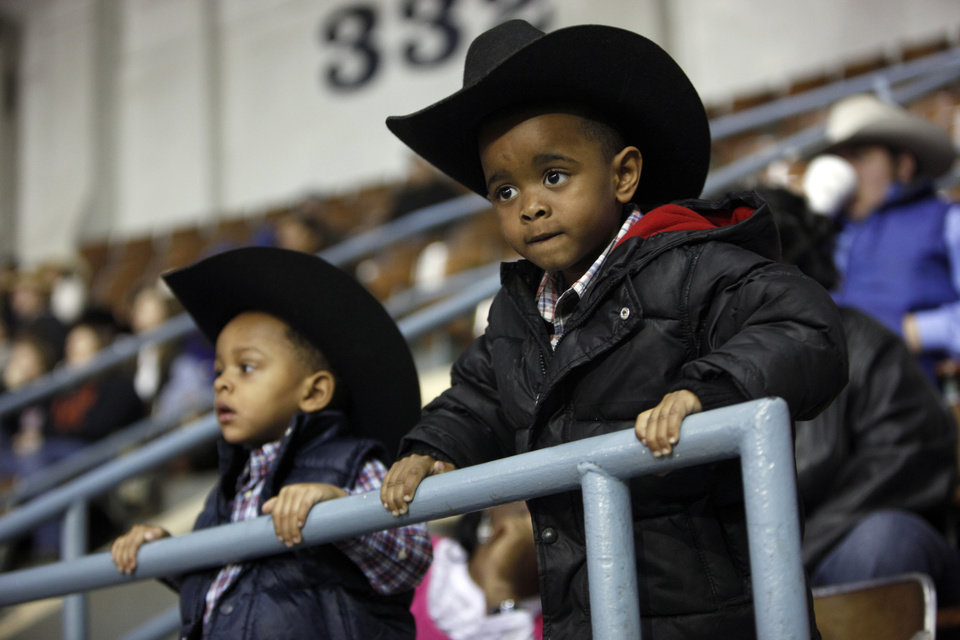 Taylor Johnson, 3, and Don Bly III, 2, watch the 42nd annual International Finals Rodeo at the State Fair Arena in Oklahoma City, Friday, Jan. 13, 2012. Photo by Sarah Phipps, The Oklahoman