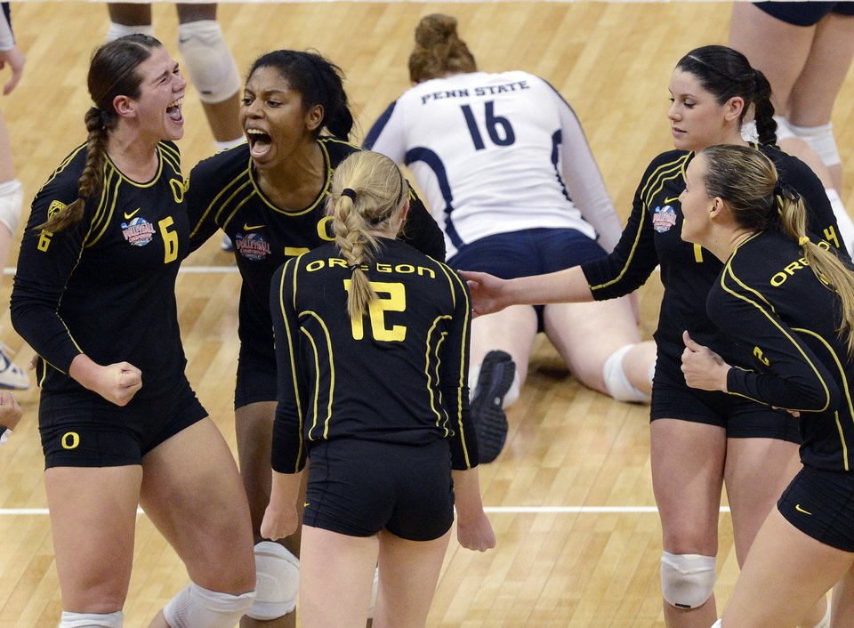 Oregon's Liz Brenner, left, and Ariana Williams, along with their teammates celebrate winning the second set of their national semifinal game against Penn State during the NCAA college women's volleyball tournament Thursday, Dec. 13, 2012 in Louisville, Ky. (AP Photo/Timothy D. Easley)