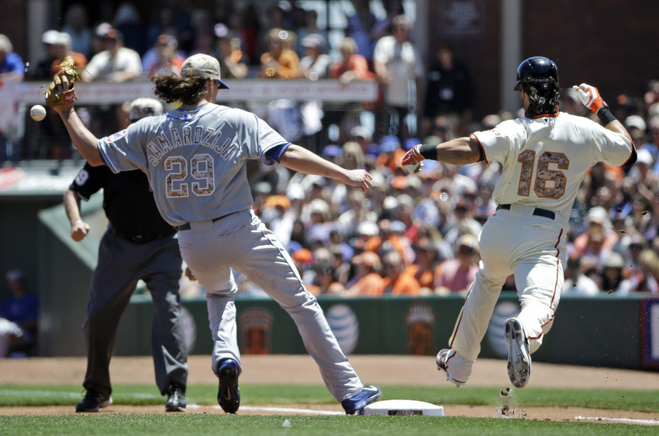Photo - San Francisco Giants' Angel Pagan, right, reaches first base safely after a fielding error by Chicago Cubs starting pitcher Jeff Samardzija during the first inning of a baseball game on Monday, May 26, 2014, in San Francisco. (AP Photo/Marcio Jose Sanchez)