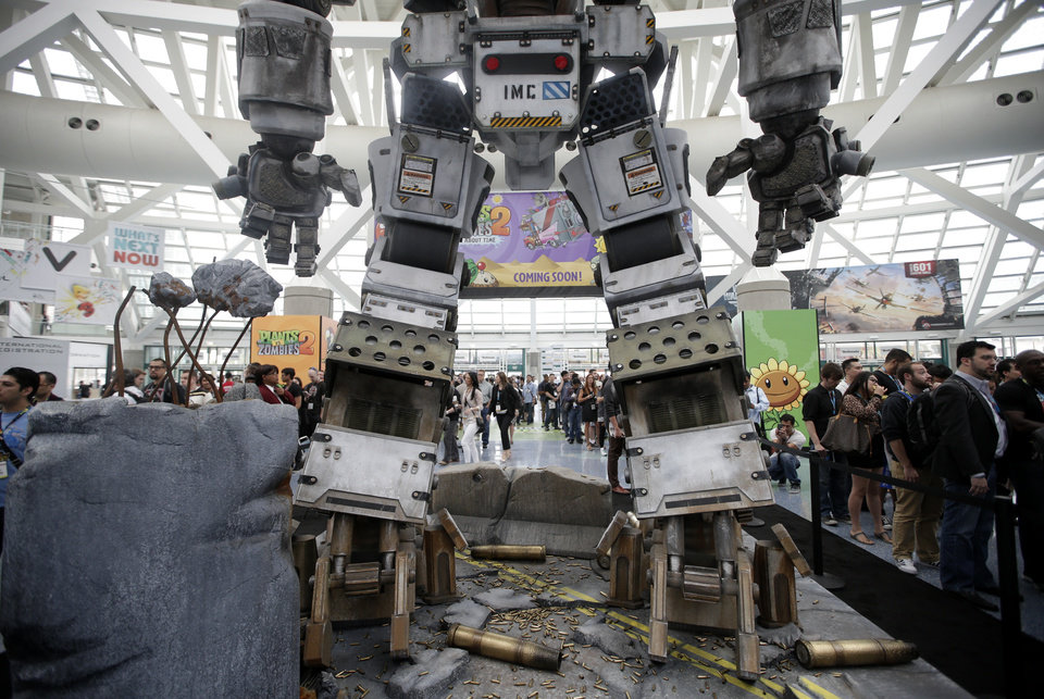 A replica of a robot from the video game Titanfall stands in the lobby area as show attendees wait in line to enter the Electronic Entertainment Expo in Los Angeles, Wednesday, June 12, 2013. (AP Photo/Jae C. Hong)