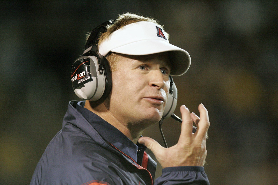 Photo - Arizona head coach Mike Stoops looks for a facemask call during the first half on Friday, Sept. 3, 2010, during an NCAA college football game against Toledo in Toledo, Ohio. (AP Photo/J.D. Pooley