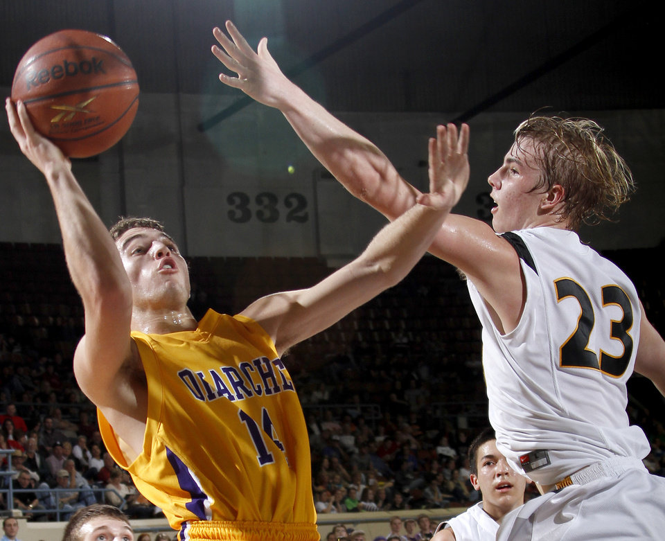 Photo - Okarche's Tyler Miller shoots the ball beside Caddo's Clayton Childree during the Class A boys basketball state tournament at the State Fair Arena in Oklahoma City, Friday, March 5, 2010.  Photo by Bryan Terry, The Oklahoman