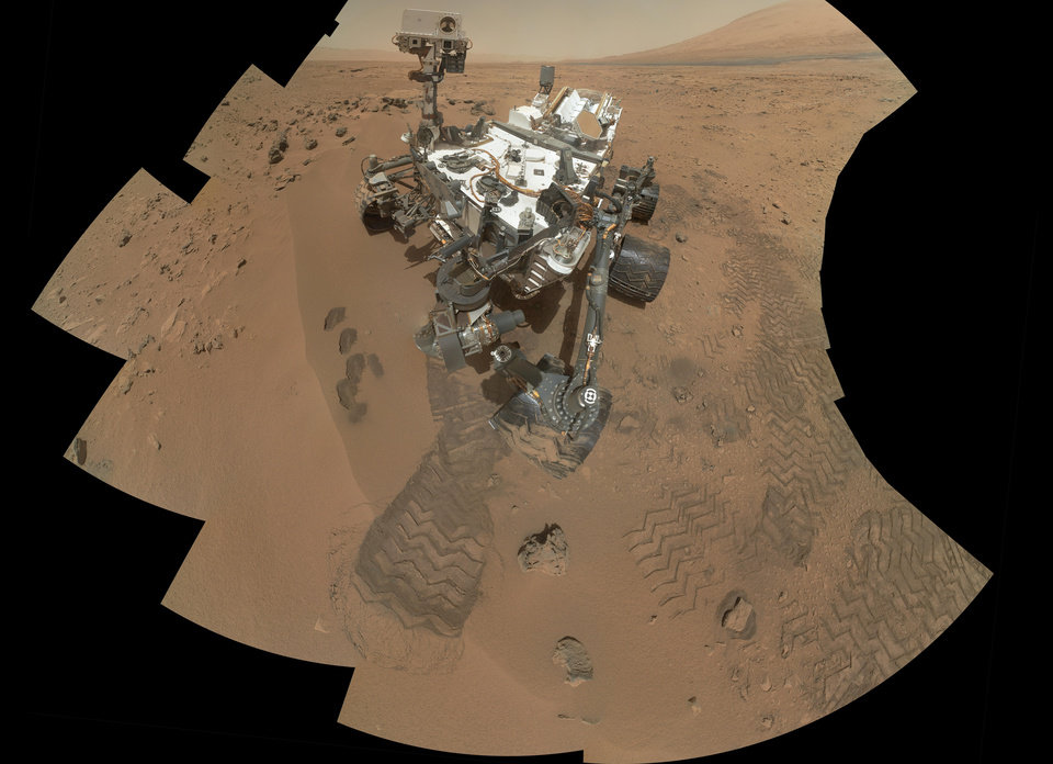 This image released by NASA shows the work site of the NASA's rover Curiosity on Mars. Results are in from the first test of Martian soil by the rover Curiosity: So far, there is no definitive evidence that the red planet has the chemical ingredients to support life.Scientists said Monday, Dec. 3, 2012 that a scoop of sandy soil analyzed by the rover's chemistry lab contained water and a mix of chemicals, but not the complex carbon-based compounds considered necessary for microbial life. (AP Photo/NASA)