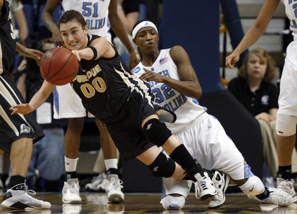 Photo - Purdue guard Jodi Howell (00) and North Carolina forward Rashanda McCants (32) try to chase down the ball in the second half of a second-round women's NCAA college basketball tournament game in Chattanooga, Tenn., Monday, March 23, 2009. Purdue won 85-70.  (AP Photo/Bill Waugh) ORG XMIT: TNMH114