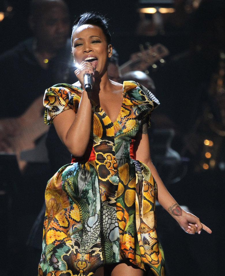 Photo -   Monica performs during the in memoriam for Whitney Houston at the BET Awards on Sunday, July 1, 2012, in Los Angeles. (Photo by Matt Sayles/Invision/AP)