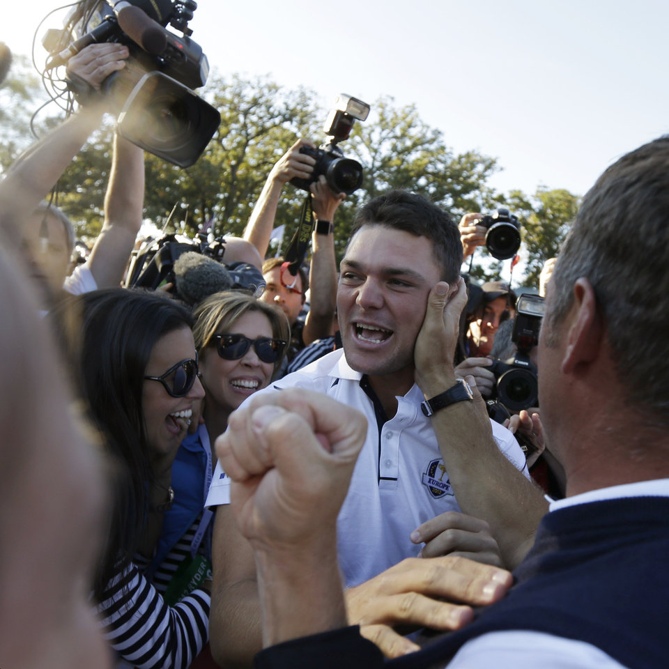 Photo - Europe's Martin Kaymer celebrates after winning the Ryder Cup PGA golf tournament Sunday, Sept. 30, 2012, at the Medinah Country Club in Medinah, Ill. (AP Photo/David J. Phillip)  ORG XMIT: PGA196