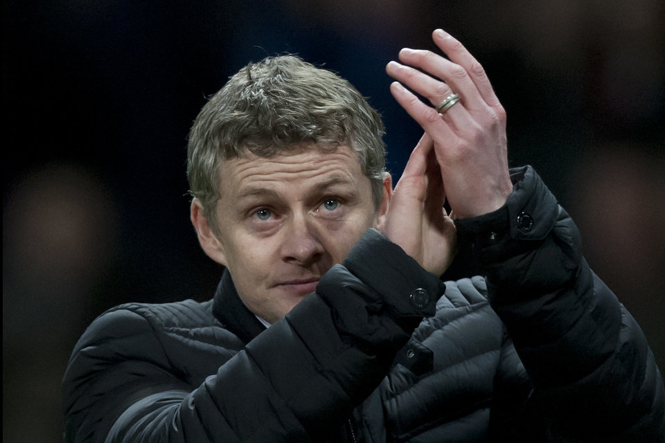 Photo - Cardiff City's manager Ole Gunnar Solskjaer applauds supporters after his team's 2-0 loss to Manchester United in their English Premier League soccer match at Old Trafford Stadium, Manchester, England, Tuesday Jan. 28, 2014. (AP Photo/Jon Super)