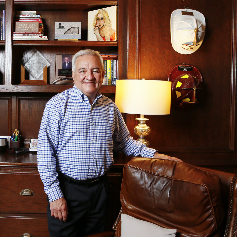 Photo -  Dave Lopez stands in his home office in Edmond. [PHOTO BY NATE BILLINGS, THE OKLAHOMAN]