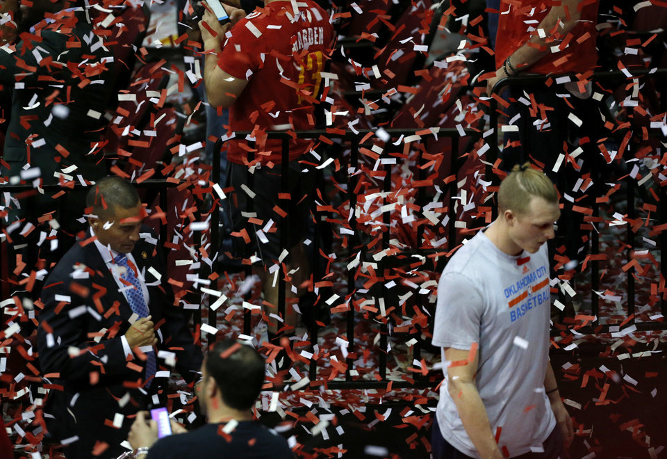 Photo - Oklahoma City's Kyle Singler (15) walks off the court following the Thunder's loss to Houston during Game 5 in the first round of the NBA playoffs between the Oklahoma City Thunder and the Houston Rockets in Houston, Texas,  Tuesday, April 25, 2017.  Photo by Sarah Phipps, The Oklahoman