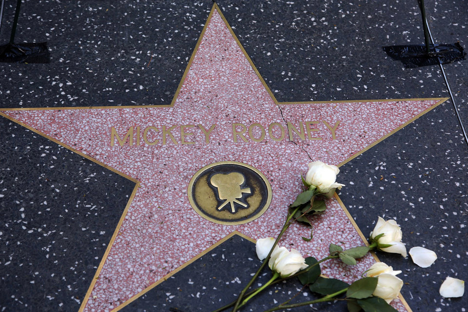 Photo - Flowers are placed on the Hollywood Walk of Fame star of Hollywood legend, Mickey Rooney, on Vine Street on Monday, April 7, 2014, in the Hollywood section of Los Angeles. The iconic actor, Rooney, died at 93 on Sunday, April 6, 2014. Over a four-decade span, he was nominated for four Academy Awards ,and received two special Oscars for film achievements, won an Emmy for his TV movie