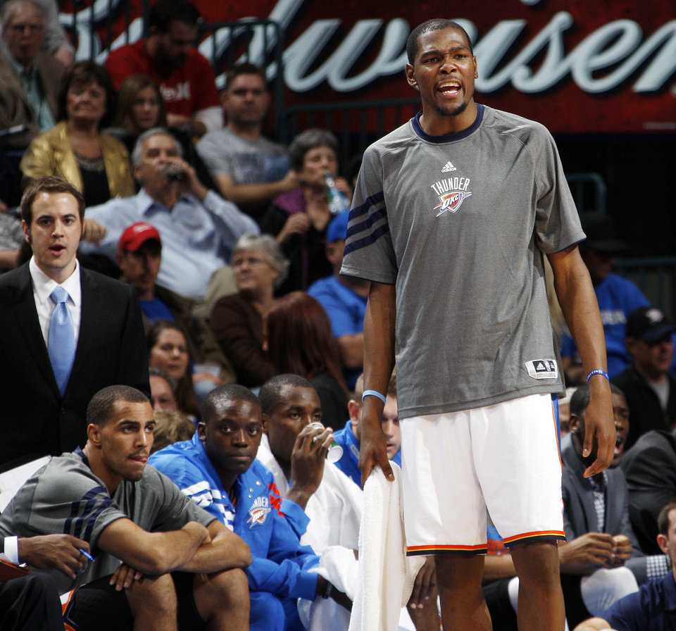 Photo - Oklahoma City's Kevin Durant (35) encourages his teammates from the bench in the fourth quarter during the NBA basketball game between the Oklahoma City Thunder and Phoenix Suns at Chesapeake Energy Arena in Oklahoma City, Saturday, Dec. 31, 2011. Oklahoma City won, 107-97. Photo by Nate Billings, The Oklahoman