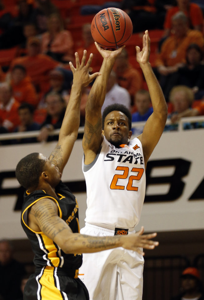 Photo - Oklahoma State's Jeff Newberry (22) shoots over Missouri Western's Aaron Emmanuel during the men's college between Oklahoma State University and Missouri Western at Gallagher-Iba Arena in Stillwater, Okla., Saturday, Nov. 8, 2014.  Photo by Sarah Phipps, The Oklahoman