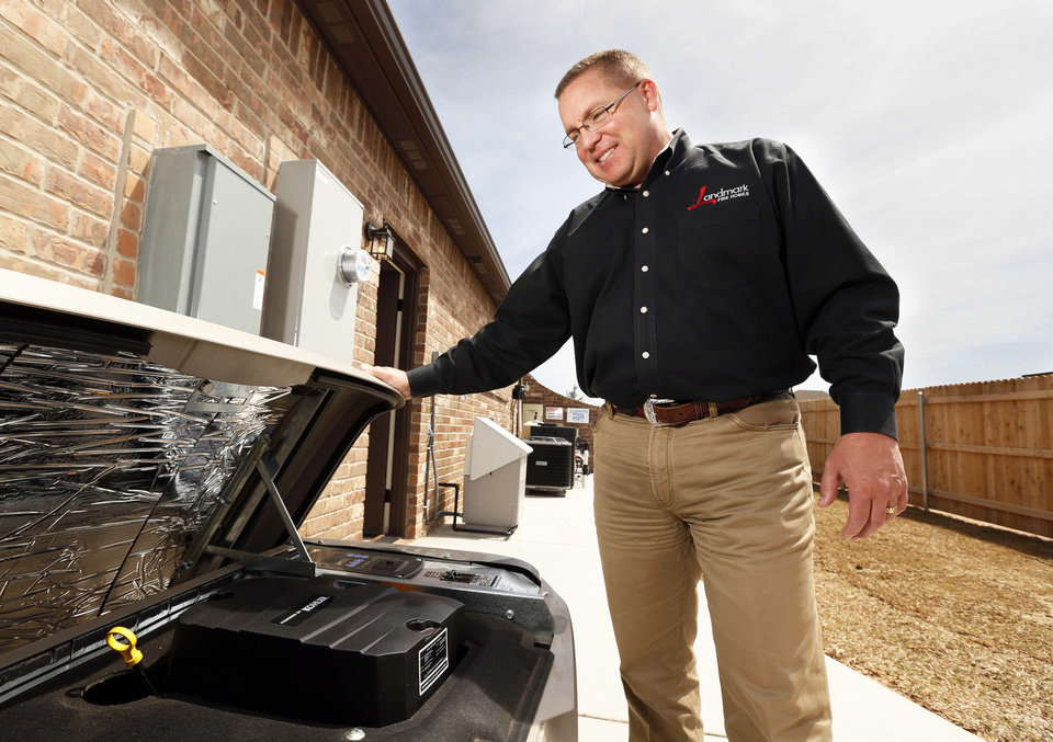 Dan Reeves of Landmark Fine Homes shows a natural gas backup generator at the model home at 4500 Northfields in Norman.