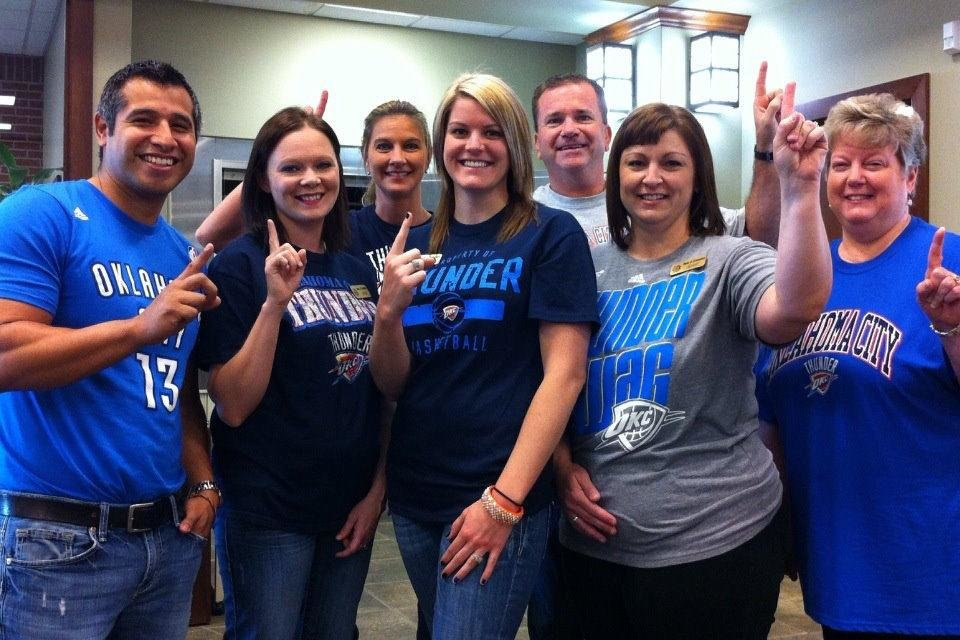Photo - From left, Gerardo Troncoso, Cora Wyles, Kathy Higgins, Lyndsey Prince, and Jay Emory, Jenny Johnson and Dara Daggs rally behind the Thunder in the El Reno branch of the Bank of Commerce. PHOTO PROVIDED